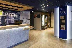 Hall ou réception de l'établissement ibis budget Lyon Centre Confluence