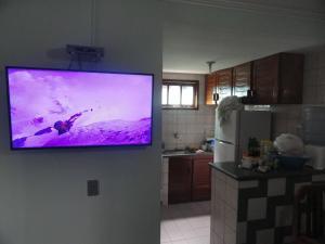 A kitchen or kitchenette at Apartamento Porto Seguro