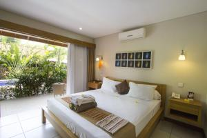 A bed or beds in a room at BaliNea Villa & Spa