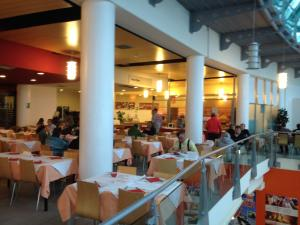 A restaurant or other place to eat at Appartamento Villaggio Olimpico