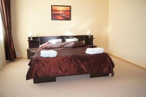 Кровать или кровати в номере Гостиница Причал