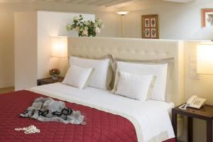 Letto o letti in una camera di Residenza D'Epoca Home In Palace