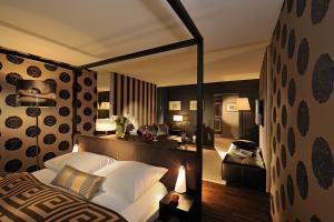 Кровать или кровати в номере Park Hotel Sonnenhof - Relais & Châteaux