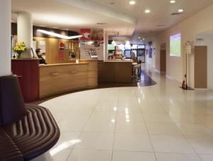 The lobby or reception area at Hotel ibis Faro Algarve