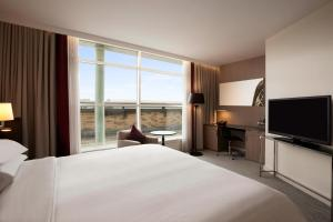 A bed or beds in a room at Hilton London Angel Islington