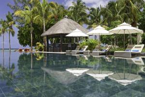 The swimming pool at or near Hilton Mauritius Resort & Spa