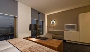 A television and/or entertainment center at COSMO Hotel Berlin Mitte