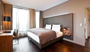 A bed or beds in a room at COSMO Hotel Berlin Mitte