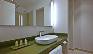 A bathroom at COSMO Hotel Berlin Mitte