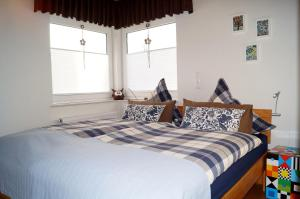 Ein Bett oder Betten in einem Zimmer der Unterkunft Ferienwohnung Am Sundern