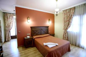A bed or beds in a room at Imperion