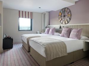 A bed or beds in a room at Village Hotel Edinburgh
