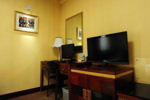 Телевизор и/или развлекательный центр в Beijing Guangxi Hotel