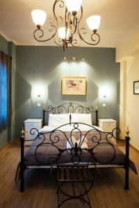 A bed or beds in a room at Acronafplia Pension B&D
