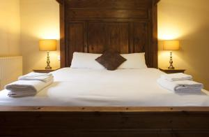 A bed or beds in a room at Avon Causeway Hotel