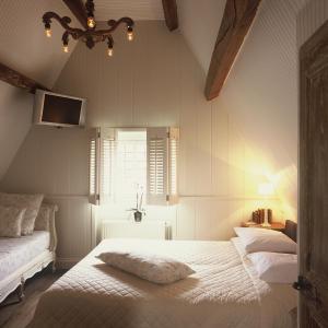 Letto o letti in una camera di Relais Bourgondisch Cruyce, A Luxe Worldwide Hotel