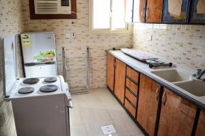 A cozinha ou cozinha compacta de Rose Al Hamra
