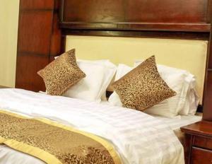Cama ou camas em um quarto em Rose Al Hamra