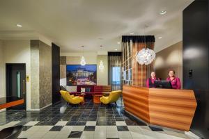 De lobby of receptie bij Hotel Capricorno