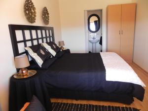 A bed or beds in a room at J&B Lodge