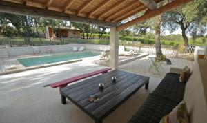 The swimming pool at or near Les Cabanes de Carelle