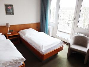 Ein Bett oder Betten in einem Zimmer der Unterkunft Zentral Hotel Poststuben