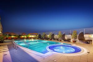 The swimming pool at or near Abidos Hotel Apartment Al Barsha