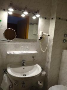 Ein Badezimmer in der Unterkunft Zentral Hotel Poststuben