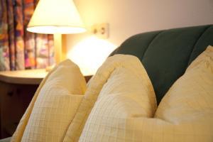 Ein Bett oder Betten in einem Zimmer der Unterkunft Raich Ferienwohnungen
