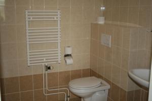 Een badkamer bij Budget Hotel Vrouwenpolder