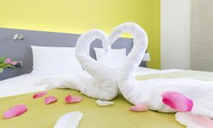 Letto o letti in una camera di Hotel Herrmes