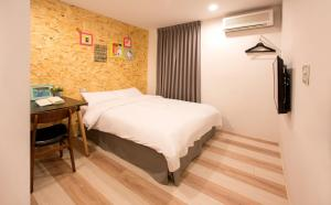 A bed or beds in a room at Light Hostel