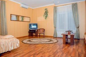 Телевизор и/или развлекательный центр в Hotel Vivat Provincia
