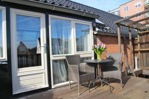 Ein Balkon oder eine Terrasse in der Unterkunft Hofje van Maas