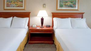 A bed or beds in a room at Quality Inn