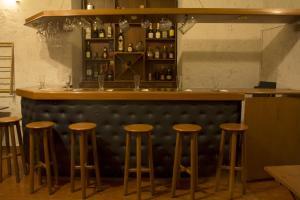 El salón o zona de bar de Posada Nueva España