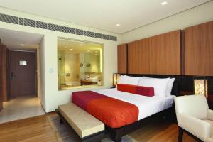A bed or beds in a room at Vivanta Surajkund, NCR