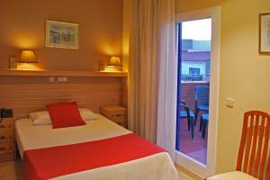 Cama o camas de una habitación en Hotel Piccadilly Sitges