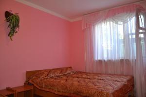 Кровать или кровати в номере Гостевой дом у Тещи