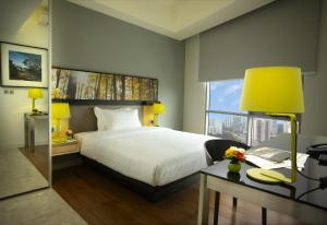 A bed or beds in a room at The Signature Hotel & Serviced Suites Kuala Lumpur