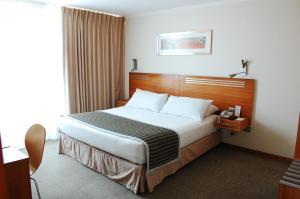 Cama o camas de una habitación en Alto del Sol Costanera Antofagasta