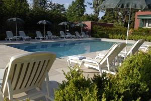 The swimming pool at or near Hotel La Barcarolle