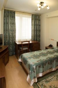 Кровать или кровати в номере Hotel RANEPA
