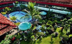 A view of the pool at Peti Mas Hotel Malioboro or nearby