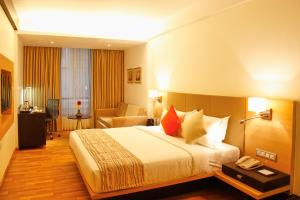 A bed or beds in a room at Meritas Picaddle Resort Lonavala