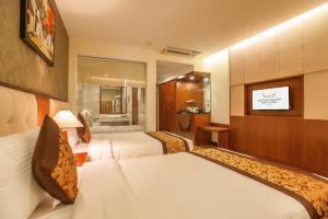 Giường trong phòng chung tại Muong Thanh Grand Bac Giang Hotel