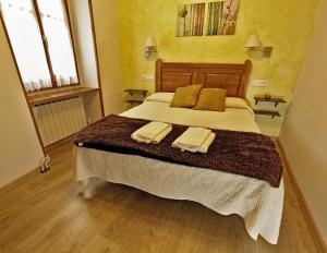 Cama o camas de una habitación en Hostal Orialde