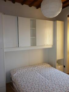 Letto o letti in una camera di Appartamenti Rio Marina