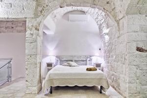 Letto o letti in una camera di La Vecchia Merceria