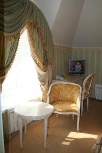 Гостиная зона в Отель Онегин